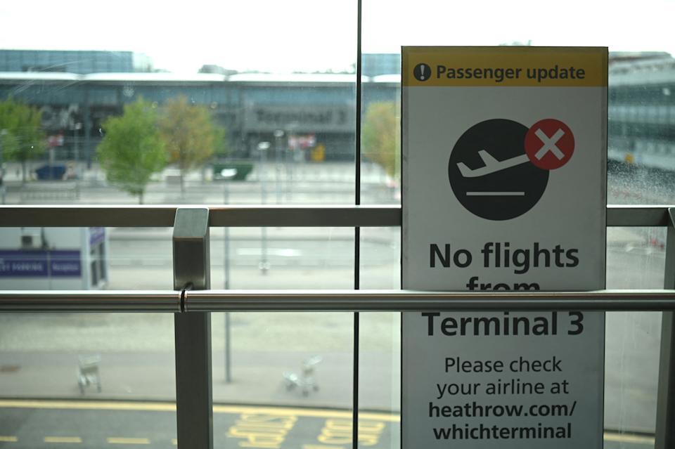 A sign displayed outside Terminal 3 at Heathrow airport in London on 3 June 2021 indicates that the terminal is closed to departure flights