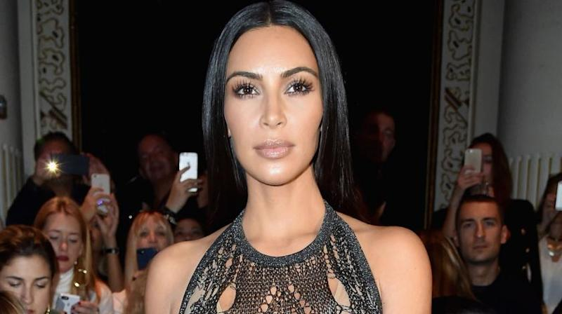 Kim revealed her surrogate was expecting on Sunday night's episode.