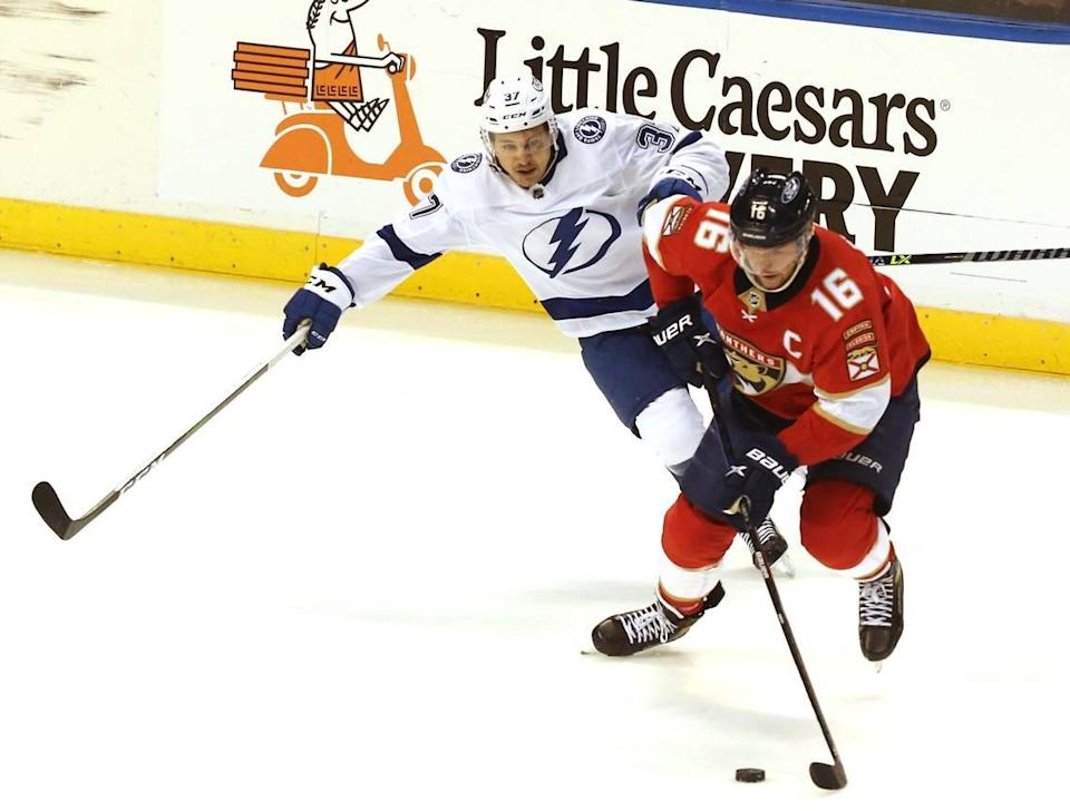 Florida Panthers Aleksander Barkov (16) and Tampa Bay Lighting Yanni Gourde (37) during the third period of game 5 of the first round NHL Stanley Cup playoff series at the BB&T Center on Tuesday, May 24, 2021 in Sunrise, Florida.