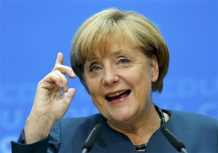 German Chancellor and leader of the Christian Democratic Union ( CDU) Angela Merkel, gestures during a news conference after a CDU party board meeting in Berlin September 23, 2013, the day after the general election. Merkel faces the daunting prospect of persuading her centre-left rivals to keep her in power after her conservatives notched up their best election result in more than two decades but fell short of an absolute majority. REUTERS/Fabrizio Bensch