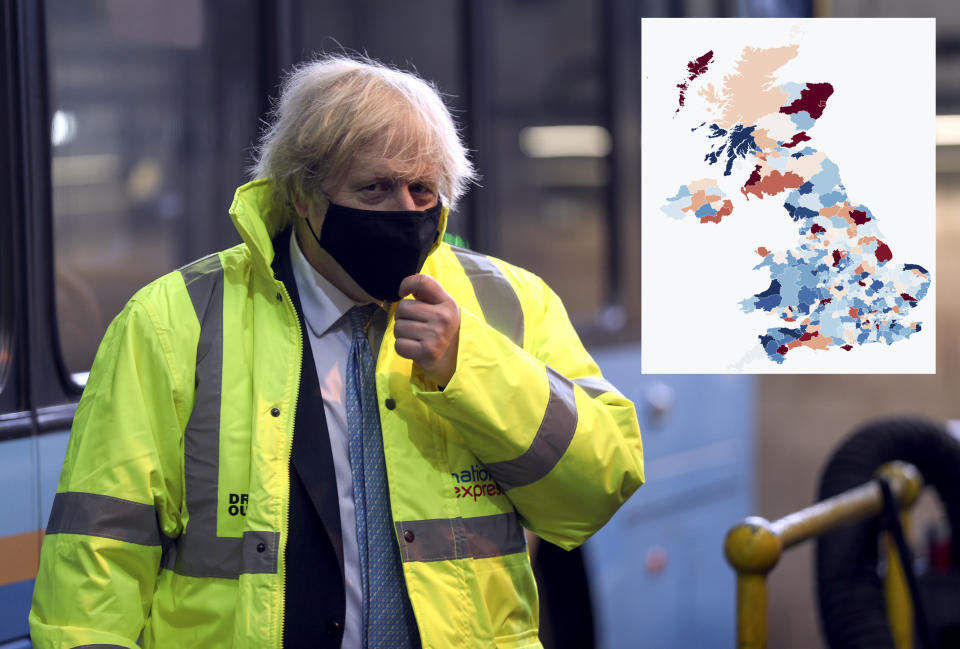 Boris Johnson in Coventry on Monday, as data showed COVID cases are rising in one in four areas of the UK. (Steve Parsons/pool/Getty Images)