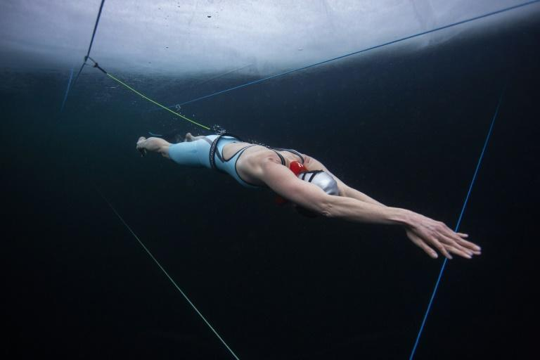 Finnish freediver Johanna Nordblad trains on March 16 ahead of breaking the horizontal under-ice freedive record on Thursday