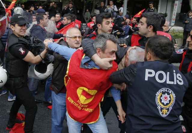 <p>Police scuffle with demonstrators during May Day protests in Istanbul, Turkey, May 1, 2018. Workers and activists mark May Day with defiant rallies and marches for better pay and working conditions. (Photo: Lefteris Pitarakis/AP) </p>