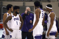TCU coach Jamie Dixon talks to players during a timeout in the team's NCAA college basketball game against Kansas State on Saturday, Feb. 20, 2021, in Fort Worth, Texas. (AP Photo/Richard W. Rodriguez)