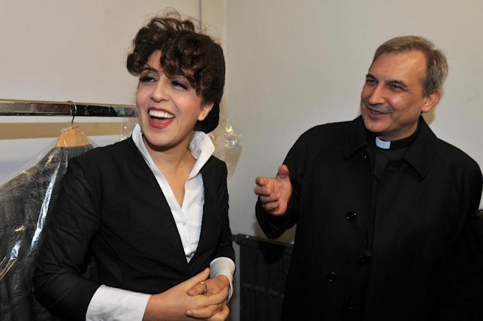 Monsignor Lucio Angel Vallejo Balda (R) stands next to Francesca Chaouqui on January 15, 2014 at the Parioli theatre (AFP Photo/Umberto Pizzi)
