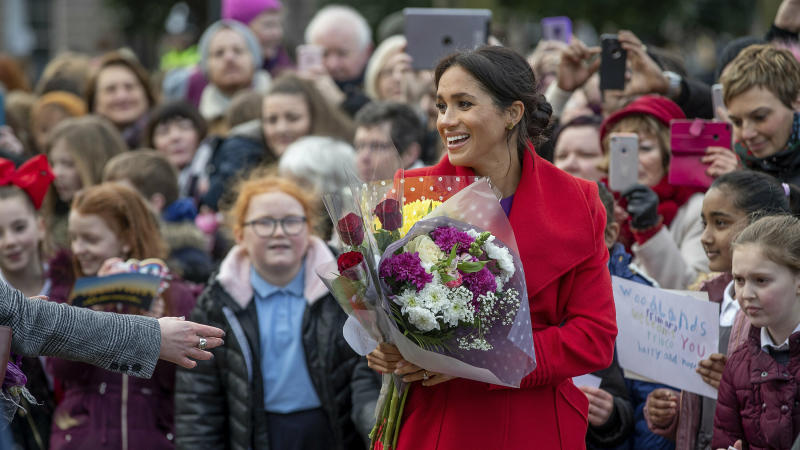 Britain's Meghan, Duchess of Sussex with Prince Harry greet the crowds of people during a visit to Birkenhead, northwest England, Monday Jan. 14, 2019. (Charlotte Graham/Pool via AP)