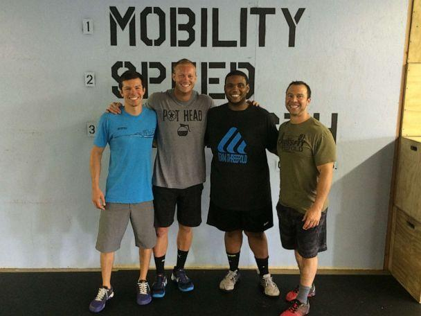 PHOTO: Romar Lyle poses with his coaches who help him continue to live a healthy lifestyle. (Courtesy Romar Lyle)
