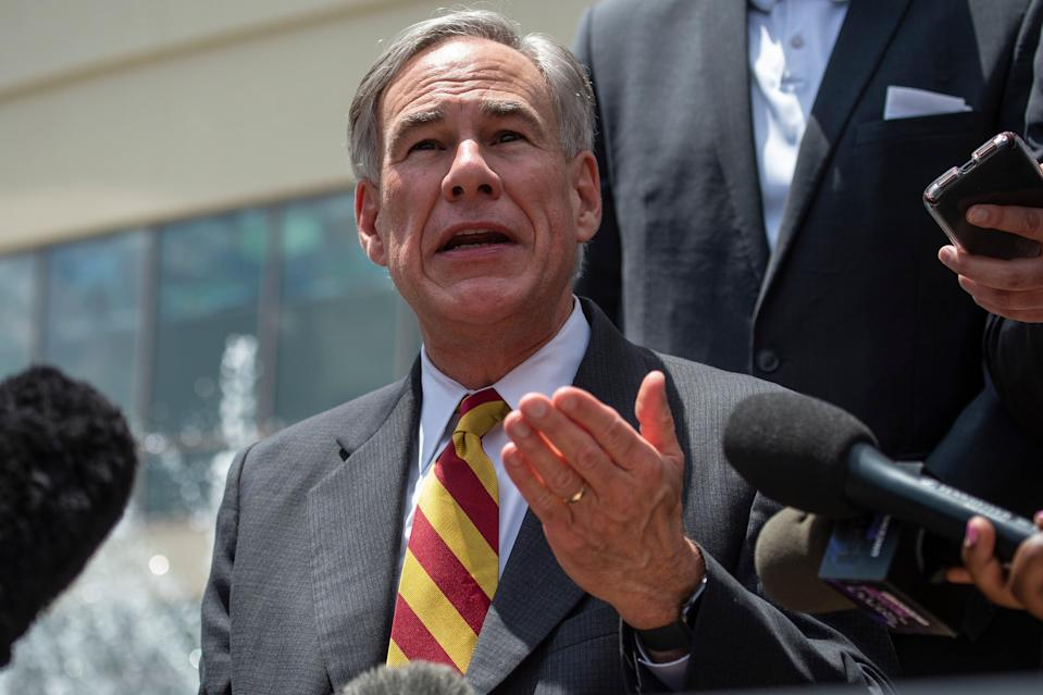 Republican Gregg Abbott claimed people could still choose to wear masks (AFP via Getty Images)