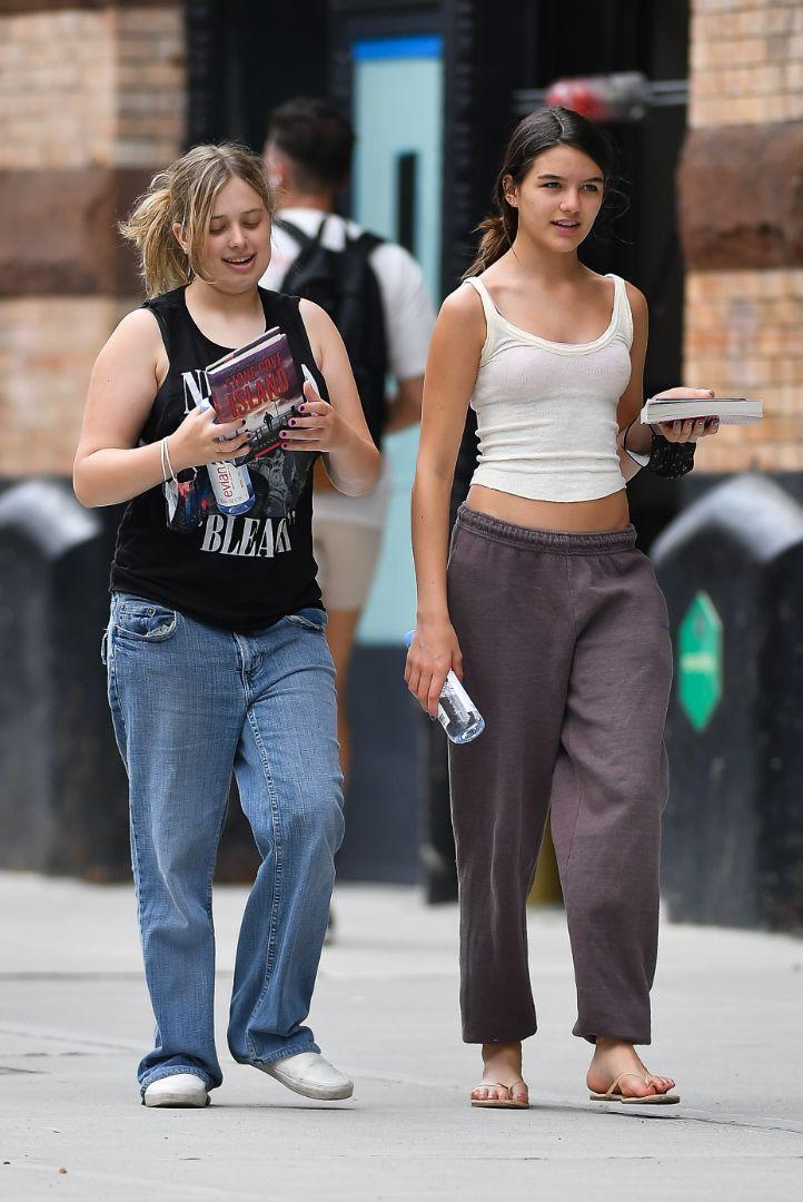 Suri Cruise (R) steps out and about in New York with a friend, July 29. - Credit: Robert O'Neil/Splash News