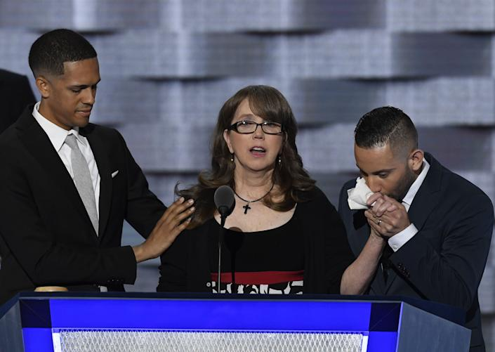 Brandon Wolf appears onstage at the the Democratic National Convention alongside Christopher Leinonen's mother and fellow survivor Jose Arriagada. (Photo: Bloomberg via Getty Images)