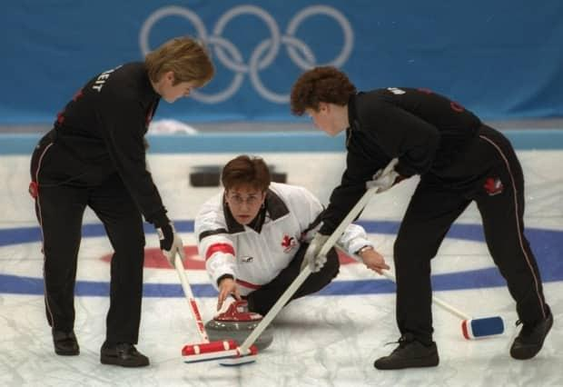 The late Sandra Schmirler, centre, skipped Canada to its first-ever Olympic curling gold medal when she won at the 1998 Games in Nagano, Japan.