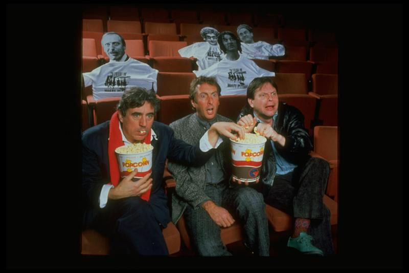 Comedians (L-R) Terry Gilliam, Eric Idle & Terry Jones eating popcorn & celebrating 20th Anniv. of Monty Python's Flying Circus; Museum of Broadcasting. (Photo by Mario Ruiz//Time Life Pictures/Getty Images)