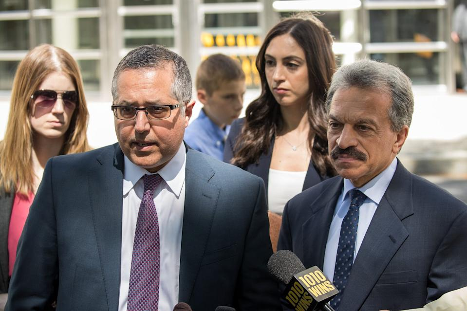 Mark Agnifilo and Paul DerOhannesian, attorneys representing Keith Raniere and Allison Mack, speak to reporters following a status conference where Raniere was again denied bail, at the U.S. District Court for the Eastern District of New York, June 12, 2018 in the Brooklyn borough of New York City.