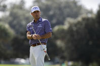 Kevin Kisner reacts to a missed birdie putt on the first green during the final round of the RSM Classic golf tournament, Sunday, Nov. 22, 2020, in St. Simons Island, Ga. (AP Photo/Stephen B. Morton)