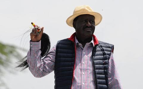 Kenyan's opposition party National Super Alliance (NASA) leader Raila Odinga looks on during a demonstration following his arrival to the Jomo Kenyatta International airport on November 17 - Credit:  AFP