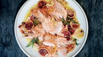 "Don't bother trying to divide this fillet into tidy portions. Instead, use a spoon to break it into perfectly imperfect pieces. <a href=""https://www.bonappetit.com/recipe/slow-roasted-salmon-with-fennel-citrus-and-chiles?mbid=synd_yahoo_rss"" rel=""nofollow noopener"" target=""_blank"" data-ylk=""slk:See recipe."" class=""link rapid-noclick-resp"">See recipe.</a>"