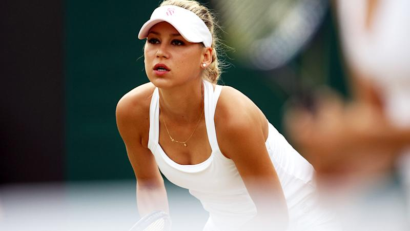 Anna Kournikova, pictured here playing doubles at Wimbledon in 2010.