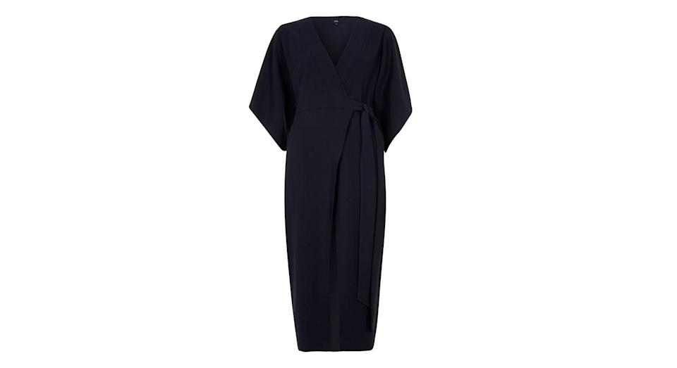 """<p>Perfect for the office, this kimono style dress will keep you looking chic – even when you CBA. <a rel=""""nofollow noopener"""" href=""""https://www.riverisland.com/p/navy-wrap-front-kimono-sleeve-midi-dress-714757"""" target=""""_blank"""" data-ylk=""""slk:Buy here."""" class=""""link rapid-noclick-resp""""><em>Buy here.</em></a> </p>"""