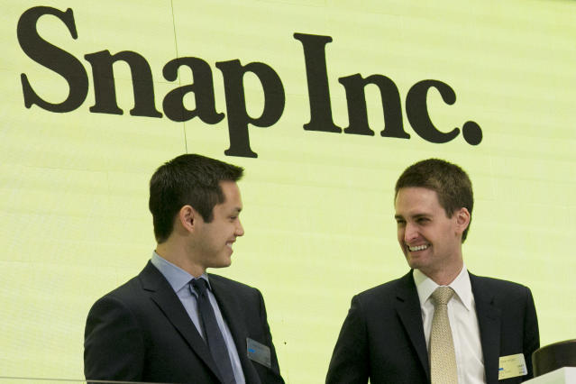 Snap co-founders Bobby Murphy, left, and CEO Evan Spiegel ring the opening bell at the New York Stock Exchange as the company celebrates its IPO. (AP Photo/Richard Drew, File)
