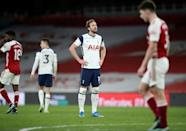 What could have been: Tottenham's Harry Kane (centre)reacts to a 2-1 defeat at Arsenal