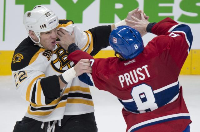 Boston Bruins' Shawn Thornton (22) and Montreal Canadiens' Brandon Prust square off during second period NHL hockey action Thursday, Dec. 5, 2013, in Montreal. (AP Photo/The Canadian Press, Paul Chiasson)