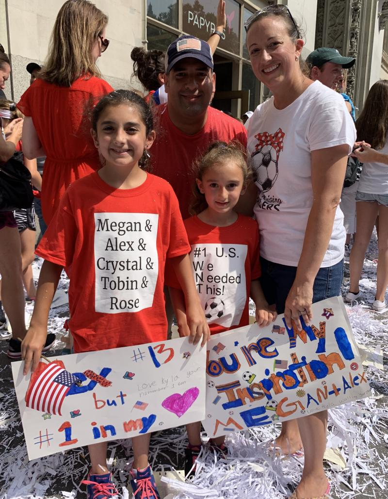 Don Walling poses with his wife, Gina, and his two daughters, Keira and Kyla, at the NYC women's soccer team parade in NYC. (Credit: Yahoo Lifestyle)