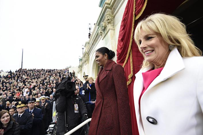 <p>First lady Michelle Obama and Jill Biden arrive on Capitol Hill in Washington, Friday, Jan. 20, 2017, for the presidential inauguration of Donald Trump. (Photo: Saul Loeb/Pool Photo via AP) </p>