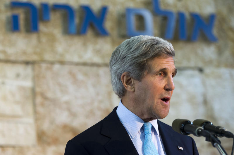 U.S. Secretary of State John Kerry speaks about his trip to the Middle East during a news conference in Tel Aviv, Israel on Sunday, June 30, 2013. Kerry engaged in breakneck shuttle diplomacy to coax Israel and the Palestinians back into peace talks over a four-day span with multiple trips to Jordan and Israel and a stop in the West Bank town of Ramallah. (AP Photo/Jacquelyn Martin, Pool)