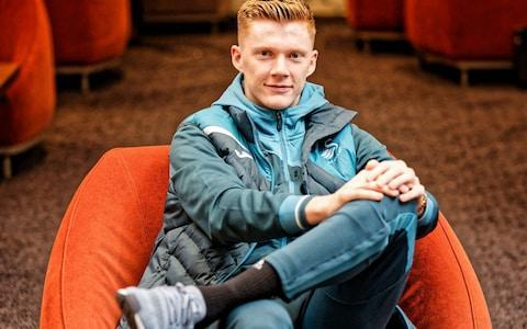 "Besides the souped-up SUV he drives, with its personalised numberplate, Sam Clucas gives few overt signals that he is Swansea City's most expensive signing. Gangly, pale of complexion, with not a tattoo or an extravagant piece of jewellery in sight, the £16.5 million man also looks markedly younger than his 27 years. ""Everyone thinks I'm 18,"" he says, with a resigned smile. ""Which is fine, apart from when you get ID-d everywhere on a night out."" At 18, Clucas was still working the till of the café at his local Debenhams in Lincoln. On Saturday, he will be hoping to light up an FA Cup quarter-final against Tottenham. Not that he has sundered his connections to a less gilded past: he plans to be at Wembley next month to watch Lincoln City, his teenage club, in the Checkatrade Trophy final, he still helps run a car logistics firm in his hometown, and he returns periodically to see the tutors at his alma mater, Lincoln College. ""They now have a classroom called the Clucas Room,"" he reveals, proudly. Clucas' winding path along the highways and byways of English football would have sunk a less resilient soul. At Leicester's academy, he was told aged 16 that he was too small to make a living in the game, even though specialists predicted – correctly, as it turned out – that he had another eight inches to grow. Even at Lincoln, under Chris Sutton, a polarising manager for whom he had little time, he started just a single match during his one-year contract and would lie awake at night, wondering if the humiliation was worth it. His peregrinations, taking in Hereford, Mansfield, Chesterfield and, most curiously, Jerez Industrial of the Spanish third tier, involved more graft than glamour. But where thousands like him had fallen by the wayside, Clucas somehow retained a faith that he was bound for greater glories than his career arc suggested. Sure enough, he secured elevation to the Championship in 2015, moving to Hull for £1.3 million. Two years later, as Swansea turned to him to fill the chasm left by departing star midfielder Gylfi Sigurdsson, he had reached the Premier League, once no more than a shimmering mirage. ""It has been an unbelievable rise,"" says Clucas, on a pristine afternoon at Swansea's training ground on the Gower. ""I do have to pinch myself sometimes. When I see guys I used to play with, they say: 'I can't believe it.' In the lower leagues, it does seem a million miles off. And yet I managed to move up five leagues in five years, with a goal in each league."" Such a feat is far rarer than his modest nature will permit him to acknowledge. Clucas could, if he attracts the attentions of Gareth Southgate any time soon, also become the first player to climb all the way from England C – a semi-professional team, comprising only non-league footballers – to the senior side. Clucas has taken huge strides forward from his England C days Credit: Athena Pictures While he arrived in south Wales with a steep price tag, many Swansea supporters were perplexed as to how Clucas would justify the money. One commentary ran with the headline: ""Who is he?"" It hardly helped his acceptance, then, when he scored just one goal in his first 17 games, kicking a water bottle in frustration as a toxic Liberty Stadium threatened to turn against him after a tepid defeat to Brighton. Any doubters of his mettle can rest assured that Clucas has already endured far worse. ""I used to look on the fans' forum when I played for Hereford, and you would see people saying, 'He's the worst player we've ever signed,'"" he reflects. ""There was one, I actually took a screen-shot of it on my phone: 'If he ever plays higher than League Two I'll eat my hat.' Now, I have turned all the social media messages off. Some of them, you wouldn't get away with in any other walk of life."" Clucas can be forgiven for romanticising the FA Cup confrontation with Tottenham on Saturday lunchtime. For it was Glenn Hoddle, still such a presence in Spurs folklore, who did much to engineer his escape from the boondocks. After his torrid experience at Lincoln, Clucas was no one's idea of a No 1 draft pick. But by happy quirk of fate, a friend managed to secure for him the last space on a trial day for Hoddle's academy at Bisham Abbey. With over 1,000 players parading their talents across five pitches, Hoddle, watching from the sidelines, saw qualities in Clucas that persuaded him to take a gamble, packing the youngster off for an unlikely sojourn in Jerez. Modern heroes: Who has done most for your club in the last 20 years? ""It was a massive step for me, because it was the first time I had been able to play consistently,"" Clucas reflects. ""The style of football helped hugely, too, because it was all on the floor, very technical. For most of the players, it was great being in a hot place – not for me, as a redhead, as my skin would get burnt in seconds – but I was just grateful to be out on a pitch every day. Without Glenn, I wouldn't be where I am now."" When Clucas scored two goals against Arsenal in January, as part of a remarkable Swansea renaissance inspired this year by manager Carlos Carvalhal, Hoddle was among the first to text with congratulations. It is unlikely, given where Hoddle's loyalties lie, that there will be much contact on Saturday. Just seeing his name on the team-sheet, though, is enough for Clucas to appreciate how far he has travelled from the morning coffee rush at Debenhams."