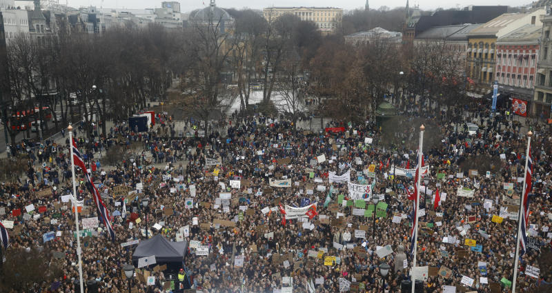 Students gather for a protest against politicians who they allege are not doing enough to halt climate change, during a mass demonstration near the parliament building in central Oslo, Norway, Friday March 22, 2019. (Tom Hansen/NTB scanpix via AP)