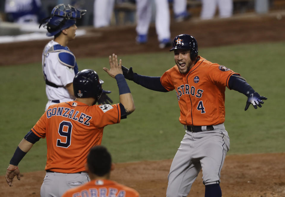 The Astros' George Springer (4) celebrates after his two-run home run against the Dodgers on Wednesday night. (AP)