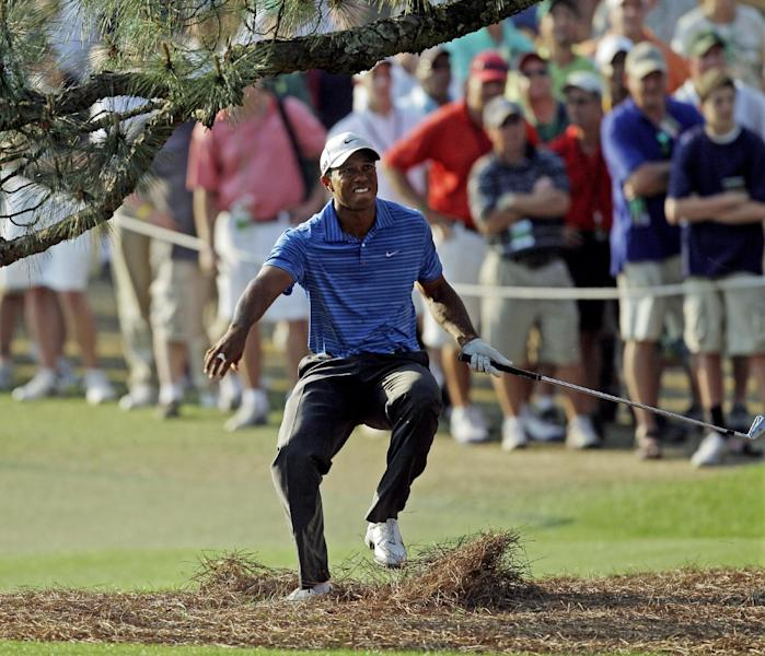FILE - In this April 9, 2011, file photo, Tiger Woods nearly falls backward after hitting out of the rough under the Eisenhower Tree on the 17th hole during the third round of the Masters golf tournament in Augusta, Ga. The Eisenhower Tree was removed this weekend because of damage from an ice storm, the Augusta National Golf Club chairman Billy Payne said Sunday, Feb. 16, 2014. (AP Photo/Chris O'Meara, File)