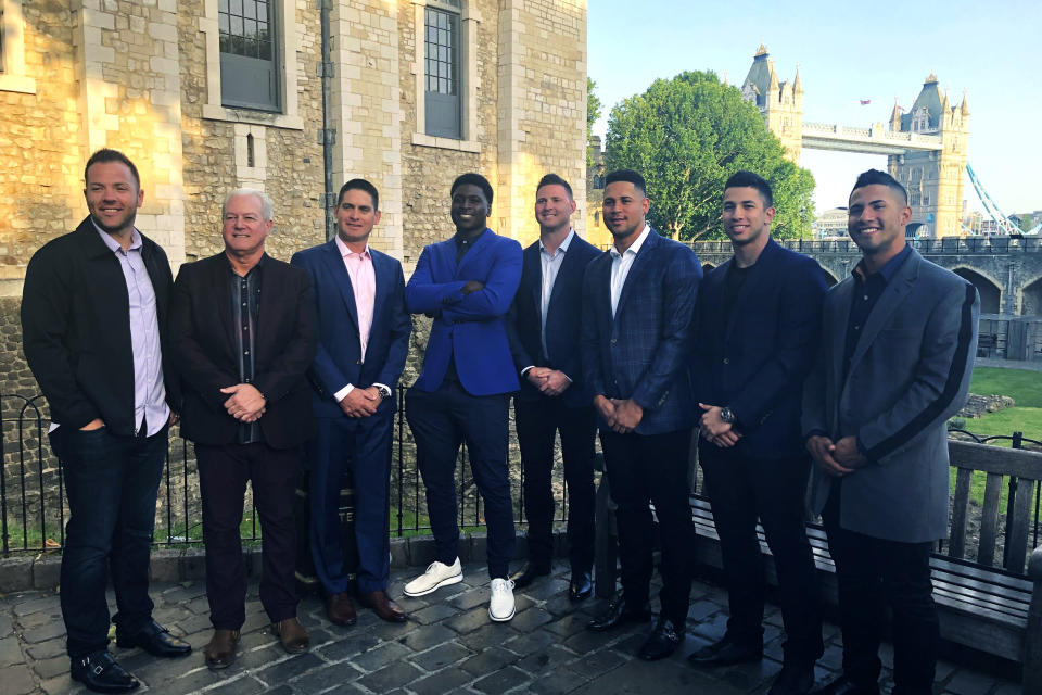 From left, New York Yankees catcher Austin Romine, batting practice pitcher Danilo Valiente, coach Carlos Mendoza, shortstop Didi Gregorius, pitcher Zack Britton, catcher Gary Sanchez, pitcher Luis Cessna and shortstop Gleyber Torres pose outside the Tower of London, Friday, June 28, 2019. At rear right is the Tower Bridge. The Yankees and Boston Red Sox are playing two baseball games in London this weekend. (AP Photo/Ron Blum)