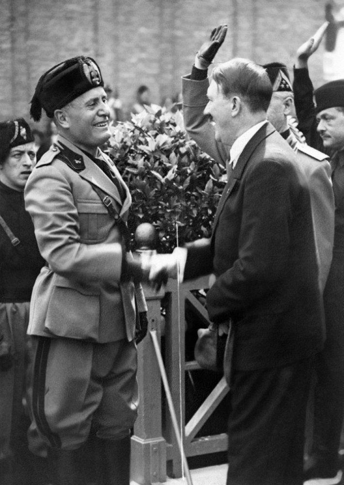 A picture taken on June 14, 1934 in Venice shows German Chancellor and Nazi Dictator Adolf Hitler (R) shaking hands with Italian dictator Benito Mussolini. AFP PHOTO FRANCE VOIR (Photo credit should read -/AFP/Getty Images)