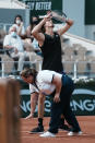 Germany's Alexander Zverev reacts as the umpire shows the mark while he plays Spain's Alejandro Davidovich Fokina during their quarterfinal match of the French Open tennis tournament at the Roland Garros stadium Tuesday, June 8, 2021 in Paris. (AP Photo/Thibault Camus)