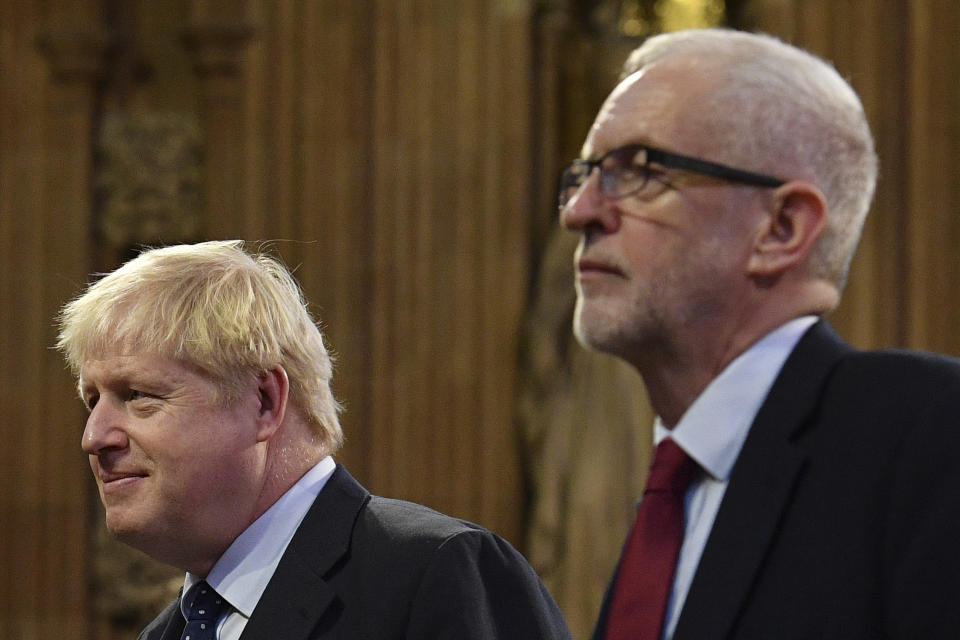 Britain's Prime Minister Boris Johnson, left, and main opposition Labour Party leader Jeremy Corbyn attend the official State Opening of Parliament in London, Monday Oct. 14, 2019. (Daniel Leal-Olivas/Pool via AP)