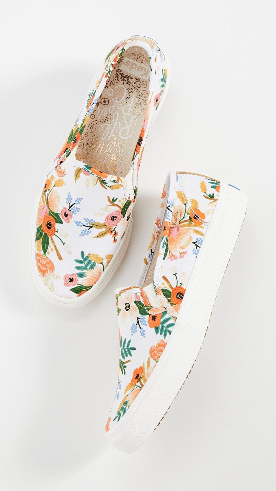 "<p>Nothing says Spring quite like these <a href=""https://www.popsugar.com/buy/Keds-Double-Decker-Lively-Floral-Sneakers-557519?p_name=Keds%20Double%20Decker%20Lively%20Floral%20Sneakers&retailer=shopbop.com&pid=557519&price=65&evar1=fab%3Aus&evar9=44311634&evar98=https%3A%2F%2Fwww.popsugar.com%2Ffashion%2Fphoto-gallery%2F44311634%2Fimage%2F47375102%2FKeds-Double-Decker-Lively-Floral-Sneakers&list1=shopping%2Cshoes%2Csneakers%2Choliday%2Cgift%20guide%2Ceditors%20pick%2Cfashion%20gifts%2Cgifts%20for%20women&prop13=api&pdata=1"" class=""link rapid-noclick-resp"" rel=""nofollow noopener"" target=""_blank"" data-ylk=""slk:Keds Double Decker Lively Floral Sneakers"">Keds Double Decker Lively Floral Sneakers</a> ($65).</p>"