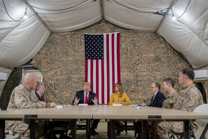 Trump flies to Iraq to visit troops for the first time