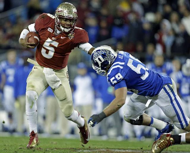 FILE - In this file photo from Dec. 7, 2013, Florida State's Jameis Winston (5) scrambles as Duke's Kelby Brown (59) defends in the first half of the Atlantic Coast Conference Championship NCAA football game in Charlotte, N.C. The No. 1-ranked Florida State held their final workout on campus Monday, Dec. 30 2013, before flying to California to face No. 2 Auburn in the BCS NCAA college football championship game. (AP Photo/Bob Leverone, file)