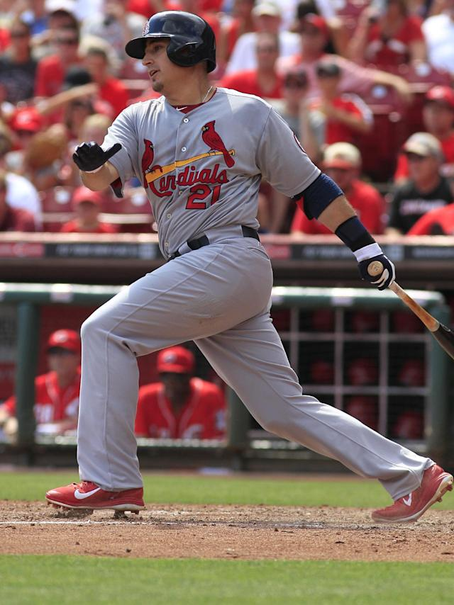 St. Louis Cardinals Allen Craig gets a hit against the Cincinnati Reds in the fifth inning in their baseball game in Cincinnati Monday Sept. 2, 2013. (AP Photo/Tom Uhlman)