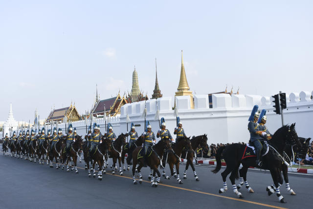 <p>Royal guards march in a procession to escort the relics and bone ashes of Thailand's late King Bhumibol Adulyadej to be enshrined in two temples in Bangkok, Thailand, Oct. 29,2017. (Photo: Anusak Laowilas/NurPhoto via Getty Images) </p>