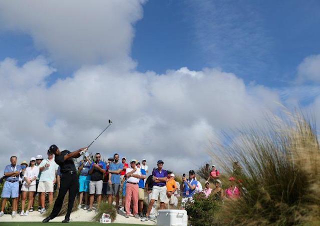 Tiger Woods tees off at the Hero World Challenge, marking his return to competitive play after a 16-month layoff. (Getty Images)