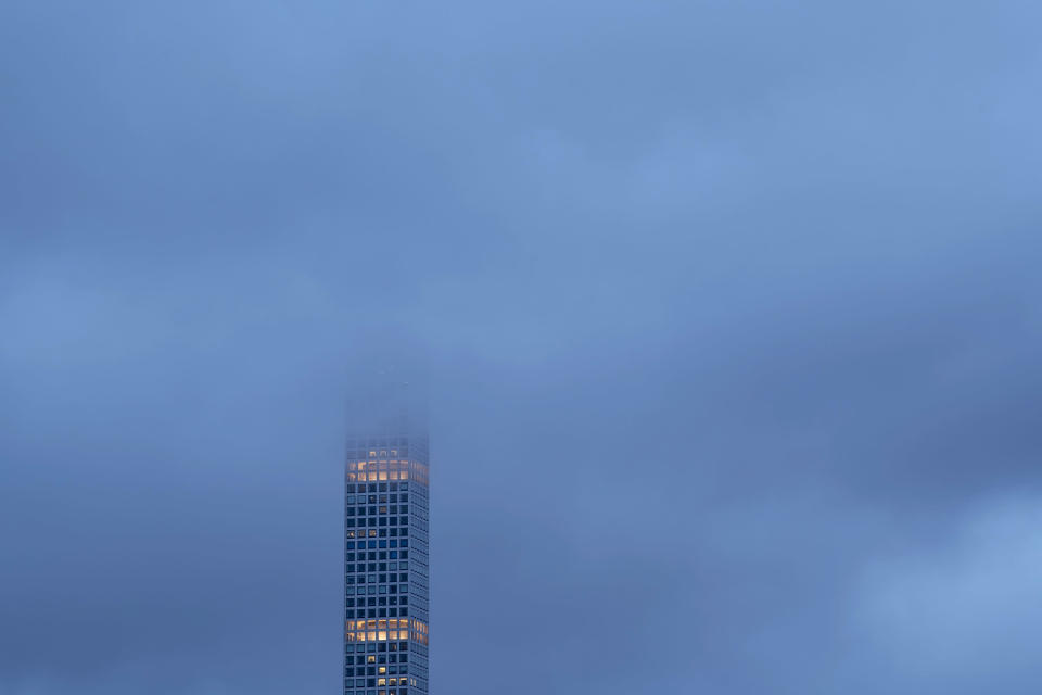 Several floors of the tower at 432 Park Avenue are surrounded by clouds in New York on May 13, 2019. (Karsten Moran/The New York Times)
