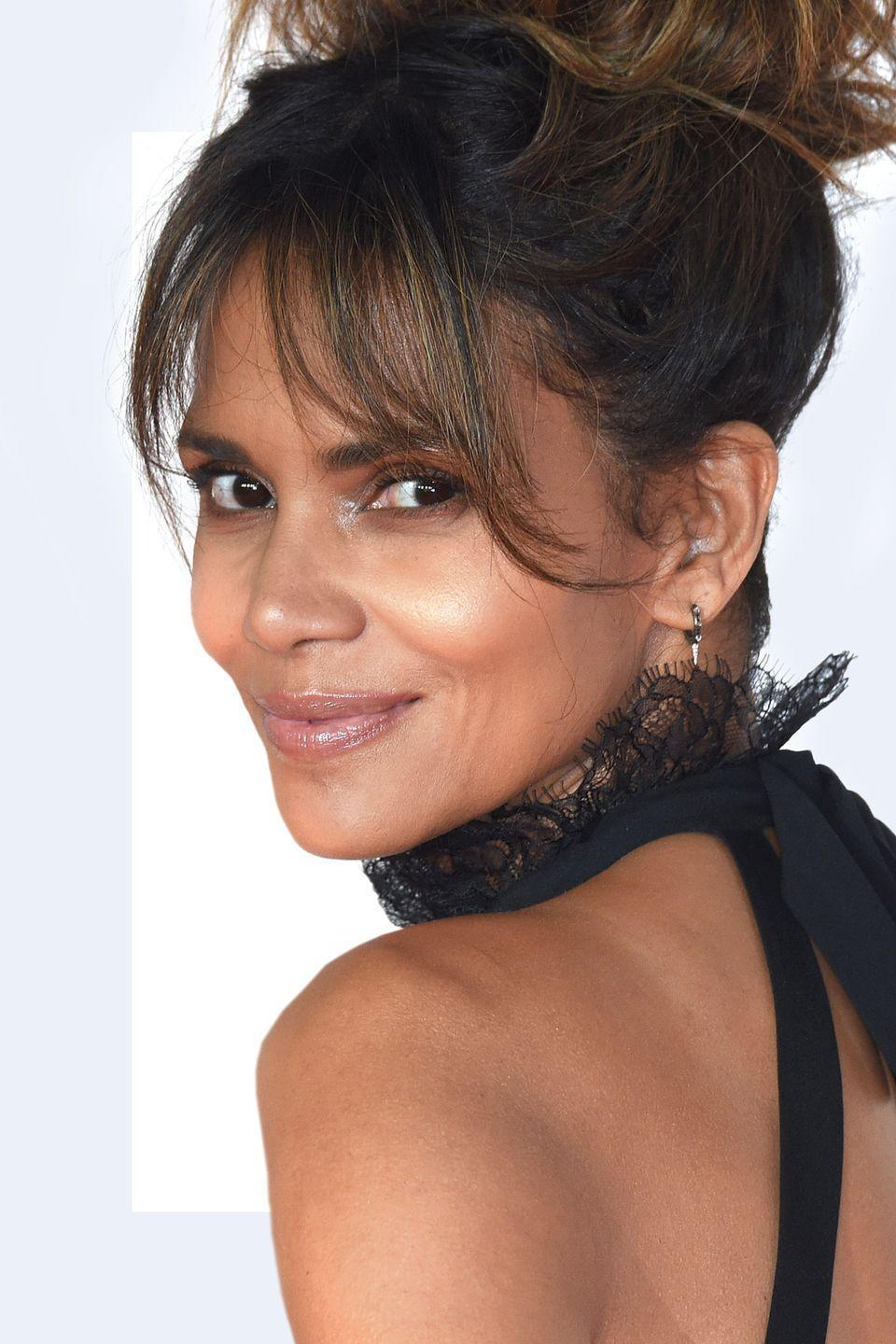 """<p>""""<strong>Longer bangs are ideal to help mask the aging process since it softens the facial features,</strong> emphasizes the eyes and also can discreetly hide fine lines and wrinkles. It's best to add layers so that there is movement and texture, rather than having stiff, coiffed hair that looks like a helmet.""""—<em>Frederic Moine, celebrity hairstylist</em></p>"""