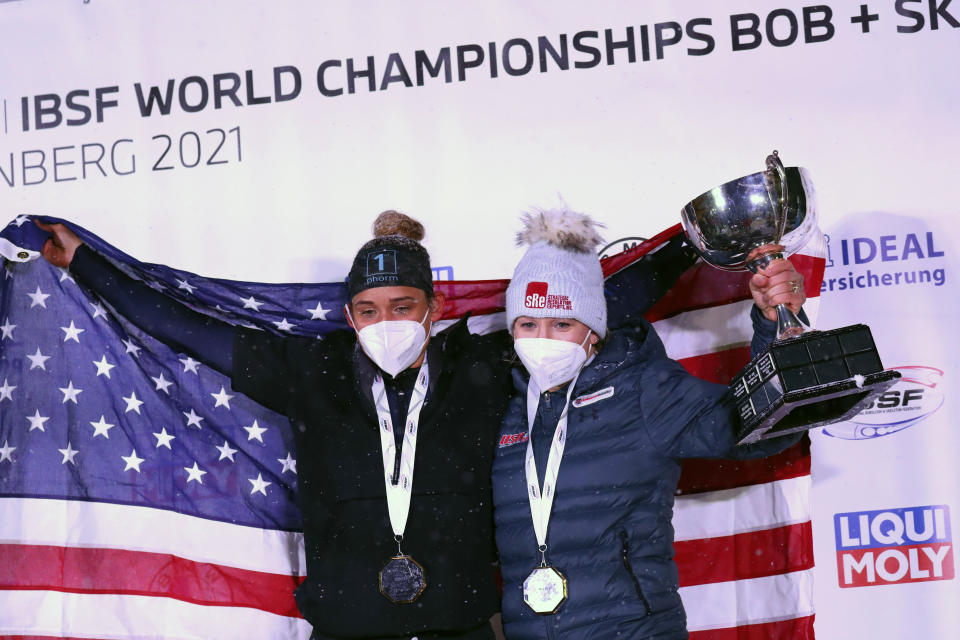 Kaillie Humphries, right, and Lolo Jones of the United States celebrate after winning the two women's bobsleigh race at the Bobsleigh and Skeleton World Championships in Altenberg, Germany, Saturday, Feb. 6, 2021. (AP Photo/Matthias Schrader)