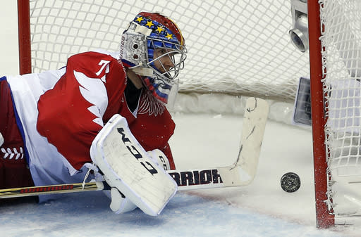 Russia goaltender Sergei Bobrovski watches the puck bounce back off the net after a goal by the USA in the second period of a men's ice hockey game at the 2014 Winter Olympics, Saturday, Feb. 15, 2014, in Sochi, Russia. (AP Photo/Petr David Josek)