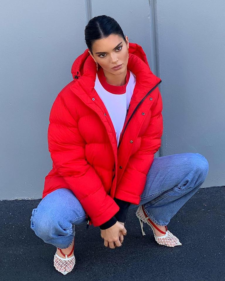 "<p>Kendall Jenner wears <a rel=""nofollow"" href=""https://fave.co/2q15KNA"">Aritzia's Tna Super Puff jacket</a> in red, styled with jeans and a ringer tee.<br /><br />(Photo: Aritzia via Instagram) </p>"