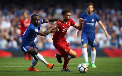 Trent Alexander-Arnold of Liverpool is challenged by Victor Moses of Chelsea - Credit: Getty images