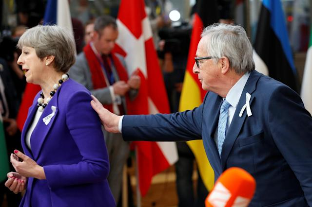 European Commission President Jean-Claude Juncker and Britain's Prime Minister Theresa May arrive at a European Union leaders summit in Brussels, Belgium, March 22, 2018. REUTERS/Francois Lenoir TPX IMAGES OF THE DAY