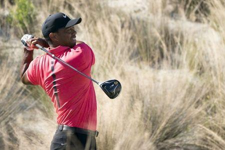 FILE PHOTO: December 3, 2017; New Providence, The Bahamas; Tiger Woods hits his tee shot on the third hole during the final round of the Hero World Challenge golf tournament at Albany. Kyle Terada-USA TODAY Sports